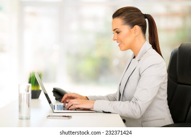 beautiful businesswoman using laptop computer in office