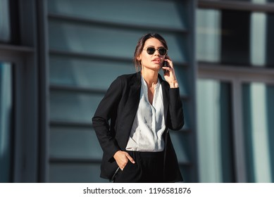 Beautiful businesswoman walking outdoors - Pretty young adult female