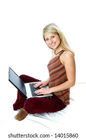 Beautiful businesswoman working with laptop and looking at camera.