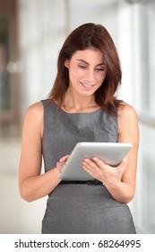 Beautiful businesswoman working on electronic tab