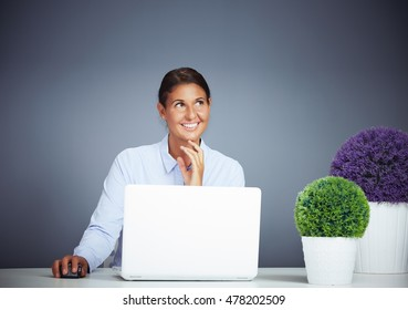 Beautiful Businesswoman Working On Her Laptop Is Having A Daydream Thinks About Something