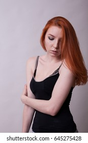 Beautiful Busty Redhead Woman In Studio Photo On Gray Background Sexuality And Sensuality Attractive