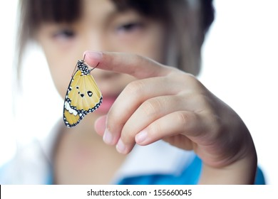 Beautiful butterfly sitting on the girl hand