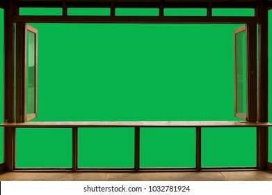 Beautiful cafe style minimal with wood tables and terrace against the outdoor with Green screen blank view isolated in cafe and clipping path.