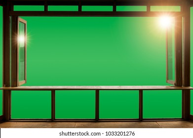 Beautiful cafe style minimal with wood tables and terrace against the outdoor with Green screen blank view isolated in cafe at sunrise and clipping path.