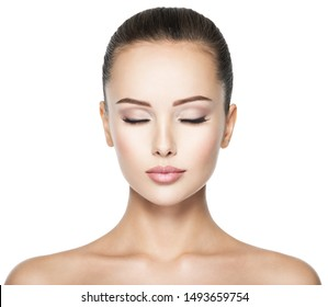 Beautiful and calm face of young woman with  health fresh skin