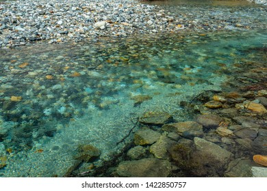 Beautiful Calm Relax Nature Background and Wallpaper of Crystal Clear Turquoise Color Stream Water Flow of Azusa River in Kamikochi, Matsumoto Nagano Japan. A Place for Nature Lover and Adventure