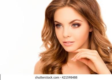 Beautiful calm sensual woman touching her chin