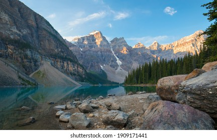 A beautiful calm summer morning at the glacial blue waters of Moraine Lake in Banff National Park, Alberta, Canada.