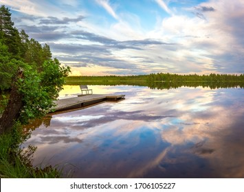 Beautiful calm summer night on the small lake in a finnish countryside