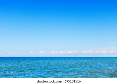 Beautiful, calm summer sea and blue sky. The background image