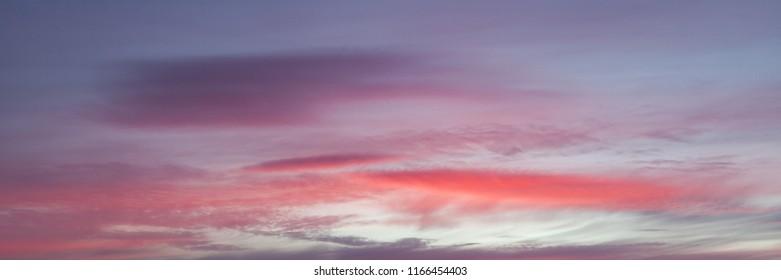 Beautiful calm sunset clouds sky background