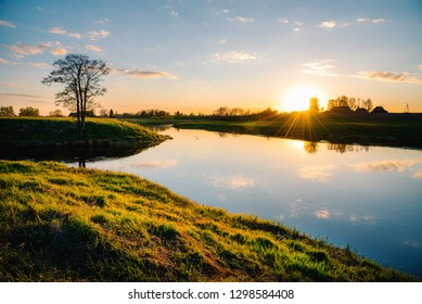 Beautiful calm sunset near the river in Lithuania