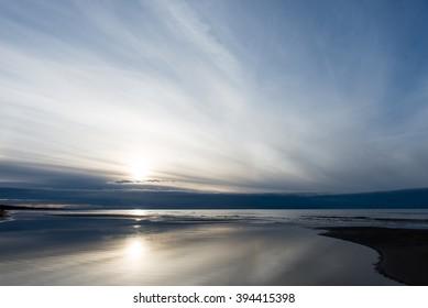 Beautiful calm sunset over the sea. Sunrise in the sea.