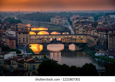 Beautiful calm sunset scene of the Ponte Vecchio bridge in downtown Florence, Italy