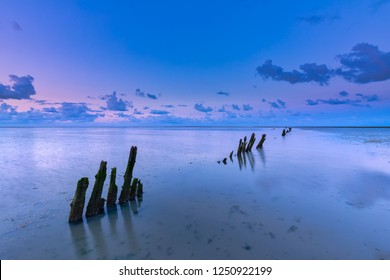 A beautiful calm and tranquil sunset over the Wadden sea with a colourful sky and clouds - Unesco world heritage site Wadden sea, Friesland, The Netherlands