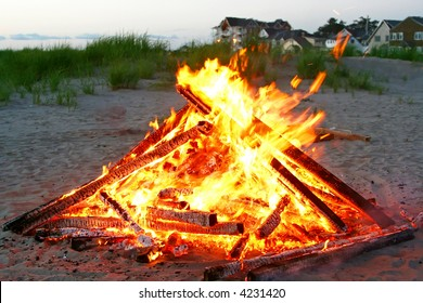 A beautiful campfire is on the beach.