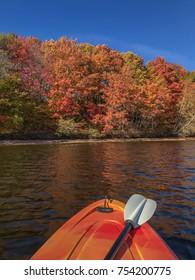 Beautiful Canadian Fall folliage in New Brunswick. Kayaking on the Saint John River in the Fall, New Brunswick, Canada