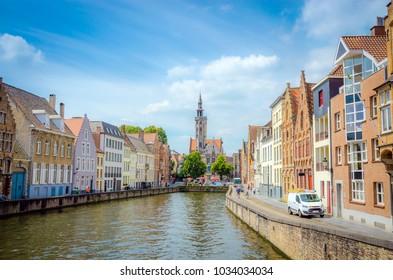 Beautiful canal Spiegelrei and Jan Van Eyck Square in Bruges (Brugge), Belgium