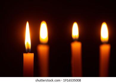 Beautiful candles burning against dark background