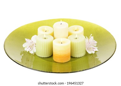 Beautiful candles with flowers isolated on white