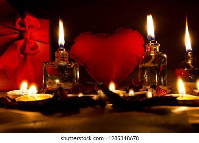 Beautiful candles and gifts burning on Valentine's Day