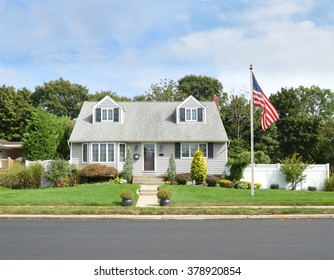 Beautiful Cape Cod Style Home Residential Neighborhood USA blue sky clouds