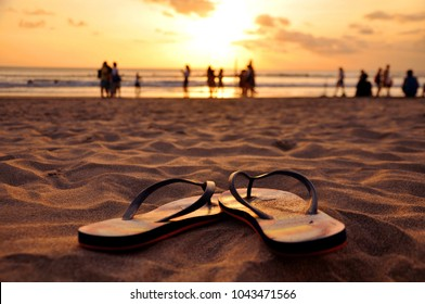 Beautiful capture of flip flops in the sand on Seminyak beach, Bali, Indonesia