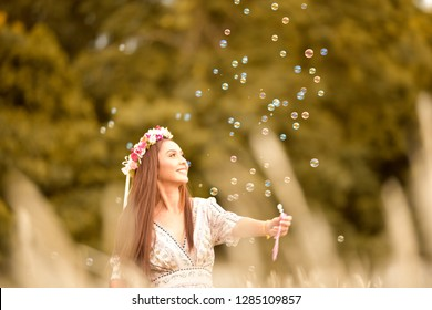 Beautiful carefree Asian woman in meadow with bubble . relaxing , freedom , vintage style for your work .