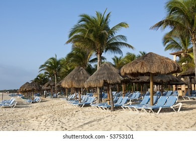 Beautiful Caribbean beach with chairs and straw umbrellas