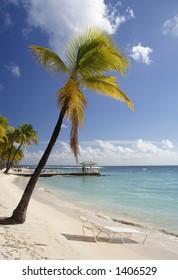 Beautiful caribbean beach with a deck chair