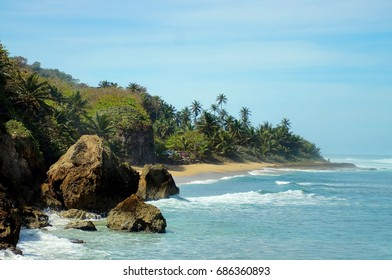 The beautiful Caribbean beaches of Puerto Rico offer crystal clear blue waters with amazing waves crashing over reef.