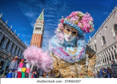 Beautiful carnival mask on San Marco square in Venice, Italy