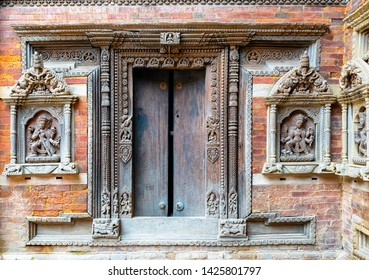 Beautiful carved wall with statue of God and Goddess in Patan Darbar Square in Royal Palace, Kathmandu, Nepal.