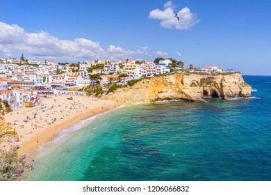 Beautiful Carvoeiro with colorful houses by wide sandy beach