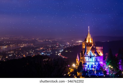 Beautiful castle at the river rhine at night.