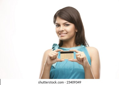 Beautiful casual girl holding a  credit card