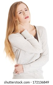 Beautiful casual woman is touching her neck. She's having neck- ache. Isolated on white.