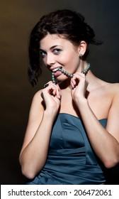 Beautiful caucasian brunette girl in gray dress