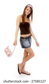 beautiful caucasian brunette model in jeans skirt with pink bag