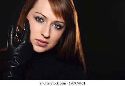 Beautiful caucasian brunette over black background