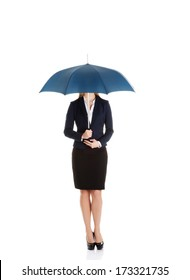 Beautiful caucasian business woman standing under umbrella. Isolated on white.