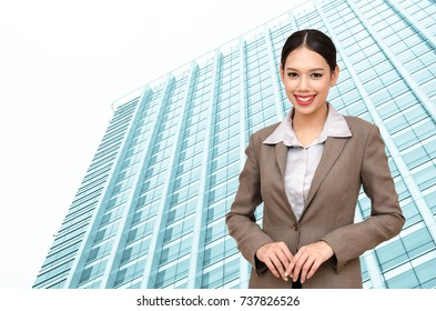 Beautiful  Caucasian business woman wear a suit  smiling and close up office building background selective focus. business success concept.
