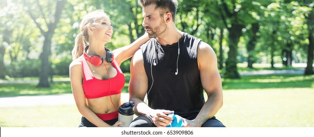 Beautiful caucasian couple training together outdoor at sunny day.