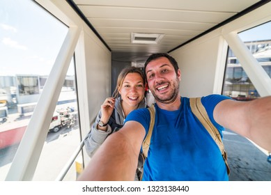 beautiful caucasian couple traveller taking selfie in the airport before journey on the flight