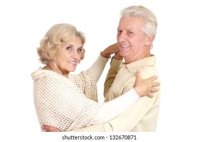 beautiful caucasian elderly couple over white background