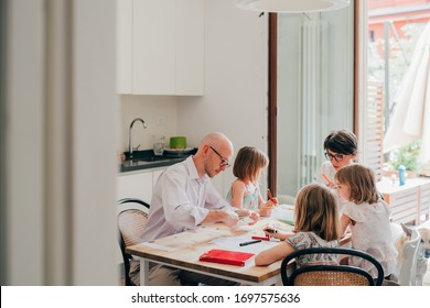 Beautiful caucasian family at home sitting table drawing - playing, home schooling, creatiity concept
