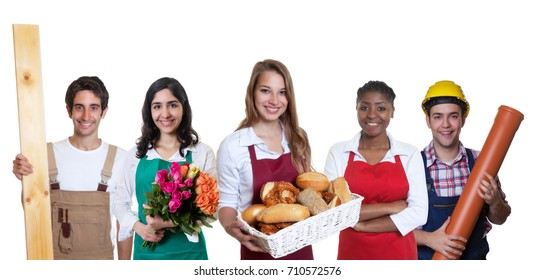 Beautiful caucasian female baker with group of other international apprentices