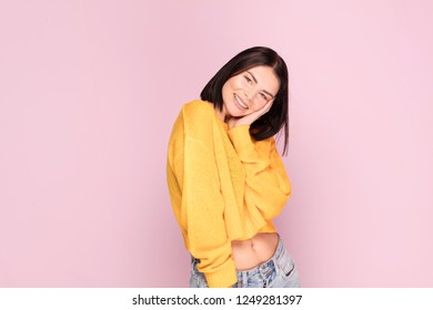 Beautiful caucasian female half-length portrait. Young happy emotional woman. Emotions, facial expression concept. Pink pastel background.