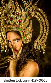 Beautiful caucasian female wearing traditional Thai headset